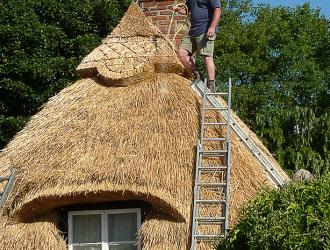 Brook Cottage being re-thatched